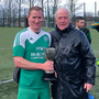 Carlingford Captain Stephen Malone accepts the cup from Mick Reilly, Chairman of the North Louth Winter League