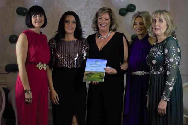 Irene Brady (committee member), Michelle McMahon, Vision Design (book producer), Sharon Tuohy (committee member), Fiona Mhic Conchoille (secretary) and Rose White (chairperson) with the commemorative book produced to mark Glenmore AC's 50th anniversary