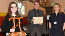 Naoise Gray-Duff winner of the Torpey award for excellence in mathematics receives her award from Joe McEneaney and Jennifer Ray at the Ó Fiaich College Junior Cycle Awards Ceremony. Picture Ken Finegan/Newspics