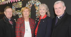 Monsignor Jim Carroll, Caroline O'Hare, Patricia Ward, Principal of St. Brigid's School and Fr. Michael Sheehan at the 50th anniversary celebration day in St. Brigid's School.