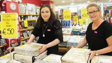 Rachel Curran and Leon O'Callaghan working in the Houstons Store on Clanbrassil Street. Photo: Aidan Dullaghan/Newspics
