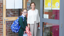 Principal Bríd Galligan greeting Dearbhla Tuite who was the first pupil to arrive for the first day of the 2020/21 School term