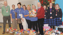 Con Shanahan and Kevin Mulligan, St. Vincent de Paul, Dundalk receiving much-needed donations from members of staff in PayPal along with teachers, and TY Students of St. Vincent's Secondary School last year