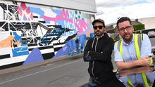 BIDS manager Martin McElligott with one of the mural artists at SEEK 2019