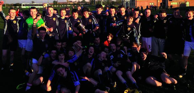 The Bush PP squad celebrate their O'Moore Cup victory on Friday.