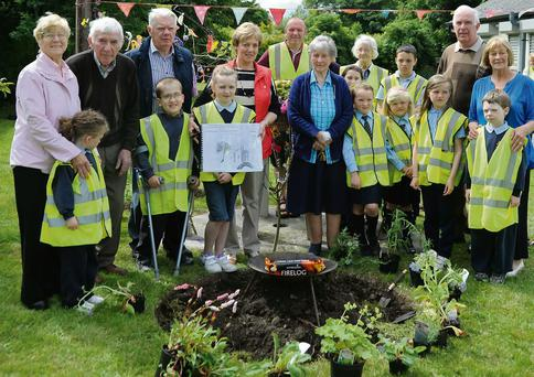 THE Dromskin Junior Tidy Towns members with their grandparents at the planing of the herb garden in Dromiskin as part of the Get Involved campaign.