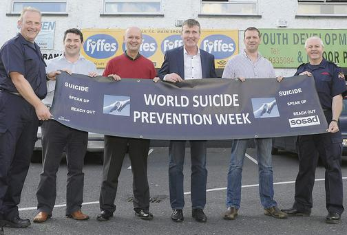 Brian Duffy and Michael Donnelly from Dundalk Fire Station with Peter Moroney and Barry Watters of SOSAD, along with Paul Johnston, General Manager at Dundalk FC, and Manager Stephen Kenny who has been unveiled as SOSAD's new patron.