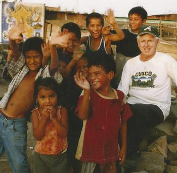 Fr Gene Kirk pictured with local poeple from the village he has worked in for the past 50 years in Peru.