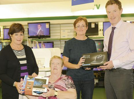 Mary Lally (left) and Rory Johnston, with Kathleen Rogers (on behalf of husband, Thomas) and Angela Foley (2nd right), prizewinners in The Argus/Lallys Electrical Tablet Competition.