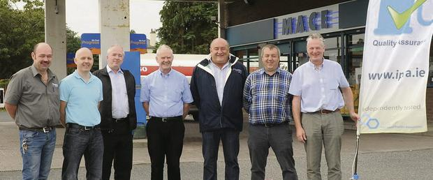 Fuel retailers at the launch of the quality assurance flag. From left: Liam Quigley of Maxol, Avenue Road; Ray Prunty of Campus, Castlebellingham, and Greenmount Service Station; Paul O'Hanlon of Topaz, Oriel, Dublin Road, and Ballymac Service Stations; Larry Muckian of Dundalk Top, Carrick Road; Paddy Bishop of Dundalk Texaco, Newry Road; Raymond Hannon of Topaz, RatRo Stores, Drogheda; and Pat Flanagan of Esso, Dublin Road.