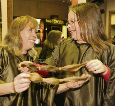 Janet and Kate Malone, who donated their ponytails to charity.