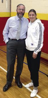 Principal of Ó Fiaich Colleg,e Padraig McGovern, with Katie Taylor during her visit to the college