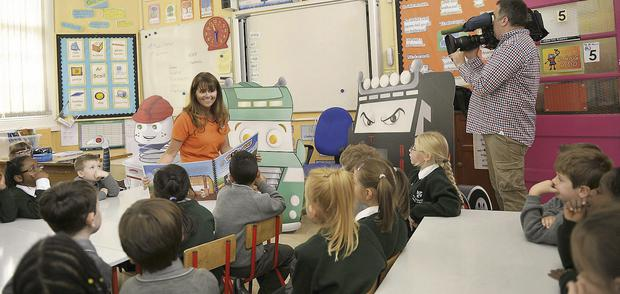 The camera rolls as local author Emer Conlon reads from her latest book in the Vroom Time series, 'Terry the Terrible Tractor', at the Friary school.