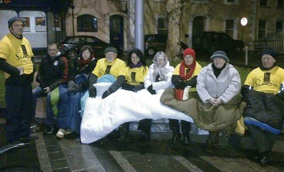 Volunteers braving the cold during the 'sleep out' at Market Square last Friday in aid of the Simon Community.