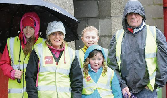 The Matthews family from Castlebellingham braving the elements to take part in the 'Operation Transformation' walk.