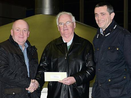 Eamon Murphy and Aidan Crowe presenting a cheque to Brian Murphy from The Birches.