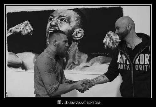 Barry Jazz Finnegan meets Conor McGregor after completing a portrait of the wrestler.