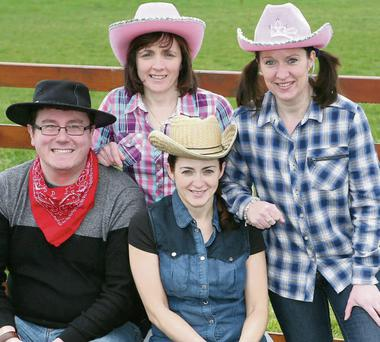 Teacher Joe McCrink with parents Gabrielle Hanlon, Rosie Hanlon and Colleen Murphy sporting their best 'country casual' ahead of the Muchgrange NS Cowboy Dance Night.