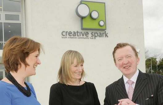 Sophie Coyle and Sarah Daly of Creative Spark, Louth Creative Community Hub, Clontygora Court, Muirhevnamor with John Perry TD Minister of State for Small Business at the Creative Spark Centre.