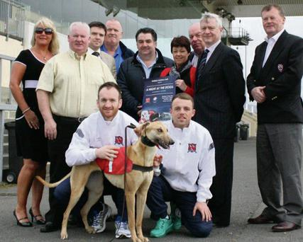 Dundalk FC players Stephen O'Donnell and Keith Ward with members of the fundraising committee: (back, from left) Ann Marie Browne, Owen Fee, Greg Molly, Paul Brown, Gerry King, Margaret Curtis, Dan Smyth, John McArdle and Des Donleavy at the launch of the the Dundalk FC 'Night at the Dogs'