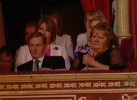 Caroline Donohoe seated behind An Taoiseach Enda Kenny at last week's 'Ceiliuradh' concert in the Albert Hall in honur of President Higgins' state visit to England.