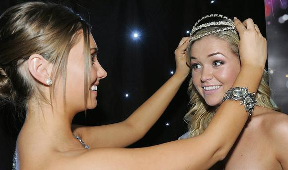 Last year's winner Sarah McCrave hands over her crown to the new Louth Rose, Ciara Soraghan.