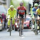 Giro cyclists making their way up Crowe Street in Dundalk; cycling has become a new way of dealing with a mid-life crisis for many men.