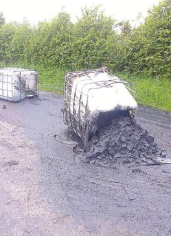 Dumped IBCs containing toxic sludge from illegal diesel laundering which were dumped at Faughart Graveyard last Thursday and which leaked onto the road.