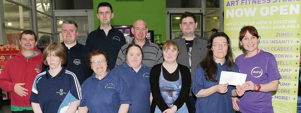 Tracy McAleavy makes a presentation to members of the Dundalk Special Olympic team in Aura Leisure Centre.