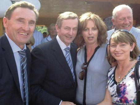 Peter Fitzpatrick TD, Taoiseach Enda Kenny with Tracy Sharkey and Collette O'Sullivan.