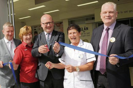 Minister of State for Business and Employment at the Department of Jobs, Enterprise and Innovation, Ged Nash TD cutting the ribbon at the official opening of Tesco Extra, Dundalk, along with Geoff Byrne, Operations Director, Tesco Ireland, Teresa McGuinness and Mary O'Donnell, longest serving Employees, Tesco Dundalk and new store manager, Brian Farrell.