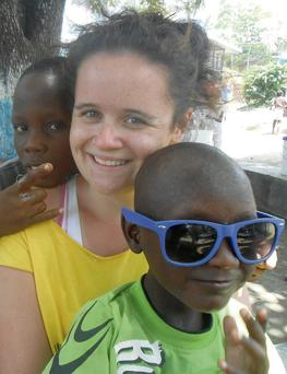 Tara Scully from Rathmount with some of the local children in Haiti