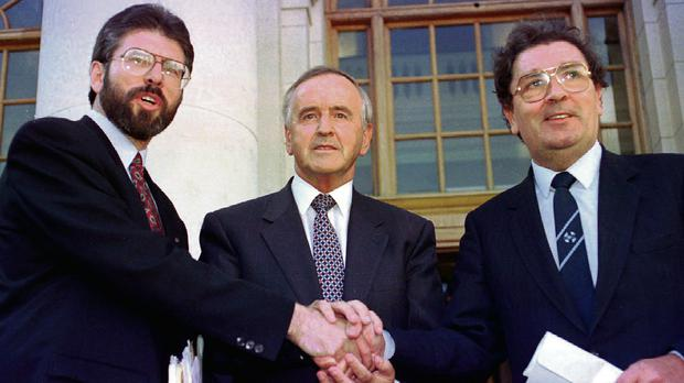 Sinn Fein leader Gerry Adams, Taoiseach Albert Reynolds and SDLP leader John Hume shake hands following their meeting at Government Buildings in Dublin in September, 1994.