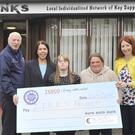 David Darcy (left), Tesco Extra, Dundalk makes a presentation to Gabrielle Renaghan, Jackie Hamill, Kelly Delaney and Emma Devlin at the launch of St. John of God North East Services LINKS Project at Hilltop, Ardee Road