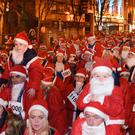 Santas throng the streets at last year's run. It is hoped the record, set in 2013, will be broken later this month