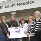 Yvonne Reynolds, Teresa Keene, Noleen Reynolds and Clodagh Mathews, with, Dundalk FC manager, Stephen Kenny, at the North Louth Hospice Shop, Ramparts Shopping Centre