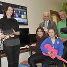 Annemarie Dowdall, The Argus, Harry Traynor, The Marshes Shopping Centre, Peter Fitzpatrick TD, Anthony Mathews, Toolfix, with Deirdre Quinn and Charlene Spencer, Maria Goretti Children's Respite Centre, Lordship, along with Eimear McCarragher at the presentation of a Smart TV, iPod, keyboard, guitar and other items. The money was raised for the items for the centre following Fitzers 5K run