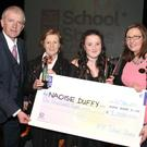 Susan O'Brien of AIB and Hubert Murphy of the Drogheda Independent present a cheque to school stars winner Naoise Duffy and Briege Galligan from St. Malachy's school