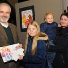 Best Picture winner Kalina Gozdek receives her award from Colm O'Gorman, Executive Director, Amnesty International Ireland watched by Jan and Iwona Gozdek at the Dundalk area Amnesty International Poster Competition presentation of prizes. Photo: Ken Finegan