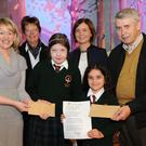 First place winners Tilly Rogers and Maya Chanda, Scoil Mhuire na Trócaire, Ardee receive their prize from Aisling Sheridan, LCC watched by Principal Deirdre Sweeney, Miriam Clarke and Brendan Matthews, Ardee Tidy Towns at the Greener Christmas Poetry Competition presentation of awards held in Scoil Mhuire na Trócaire, Ardee. Photo: Ken Finegan