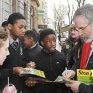 Sinn Féin general election candidate Gerry Adams signing autographs for students in Dundalk Town Centre