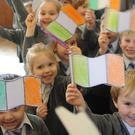 Pupils celebrating Proclamation Day at CBS Primary School
