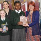 Nicola Pierce (third left), presents the prizewinners in the 1916 Short Story Competition to Cara Sheehy, Tola Oladejo and Eimear Farrell, St.Malachy's Girls' School with Teacher, Danielle Duffy, along with Bernadette Fennell and Amanda Branigan, Dundalk Library