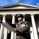 Captain Peter Kelleher from the 27th Infantry Battalion, reading the Proclamation at the GPO, O'Connell Street