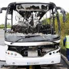 The burnt out Bus Eireann bus following the fire on the M1