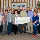 National Pen staff make a cheque presentation to the Birches Day Care Centre
