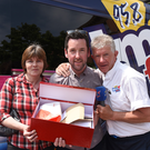 Town Centre Manager Martin McElligott together with LMFM presenter Pat O'Shaughnessy presents JackieKeenan, Inniskeen, with her prize at the Radio Roulette €5,000 Giveaway