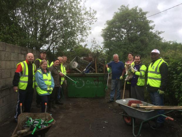 Thomas Byrne, Fergal Sheehy, Charlie O'Brien and Anto Heeney from Cox's Demesne Community Volunteers, with Kayleigh Mulligan of Louth Volunteer Centre and a few of the volunteers that helped with the Saturday clean up