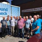 Jeff Walbarn and Gary O'Brien from Specsavers with members of the Dundalk Community Men's Shed
