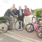 Fergus McArdle, Tony Nordon, Oliver Nixon and Gay Berkery, Dundalk Rotary Club with Bikes at Aura Leisure Centre for the Bikes for Africa Project